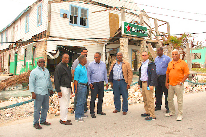 Pictured from left in West End, Grand Bahama: Preston Cunningham, Senior Administrator for Grand Bahama; Melvin Seymour, Permanent Secretary; Jack Thompson, Permanent Secretary; Gowon Bowe, disaster relief committee; the Hon. Dr. Michael Darville, Minister for Grand Bahama; Nathaniel Beneby, disaster relief committee; Mike Maura, disaster relief committee; Captain Stephen Russell, Director, NEMA; and Tracey Knowles, disaster relief committee. (BIS Photo/Patrick Hanna)