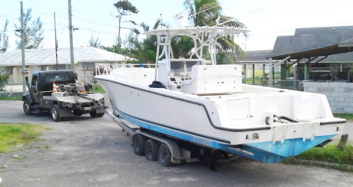 SeaVee stolen boat being recovered Nassau Village Dec 3 (white hull) Police from Nassau's Marine Unit tow the recovered 34-foot SeaVee from the car wreck yard found behind a church in Nassau Village. The boat was hunted down over a 10-day period by a friend of Cliff Bootle, Marina Manager at Treasure Cay, a member of The Association of Bahamas Marinas.